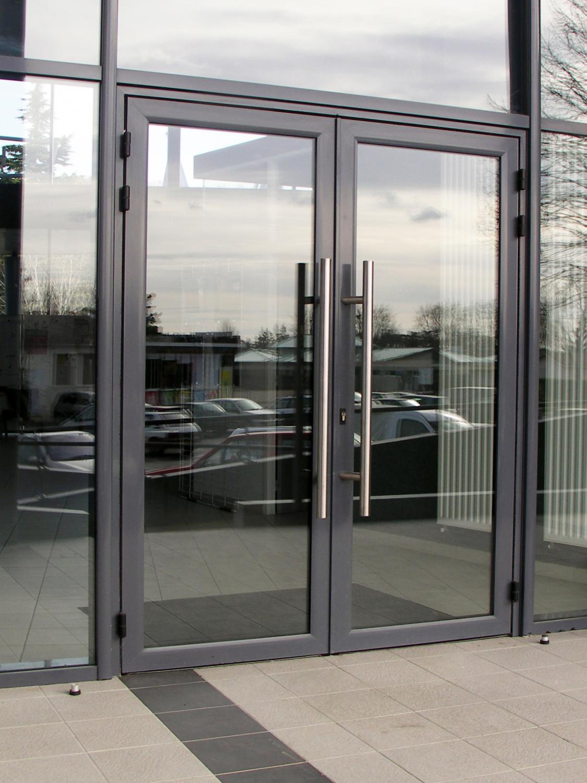 1) Porte Aluminium